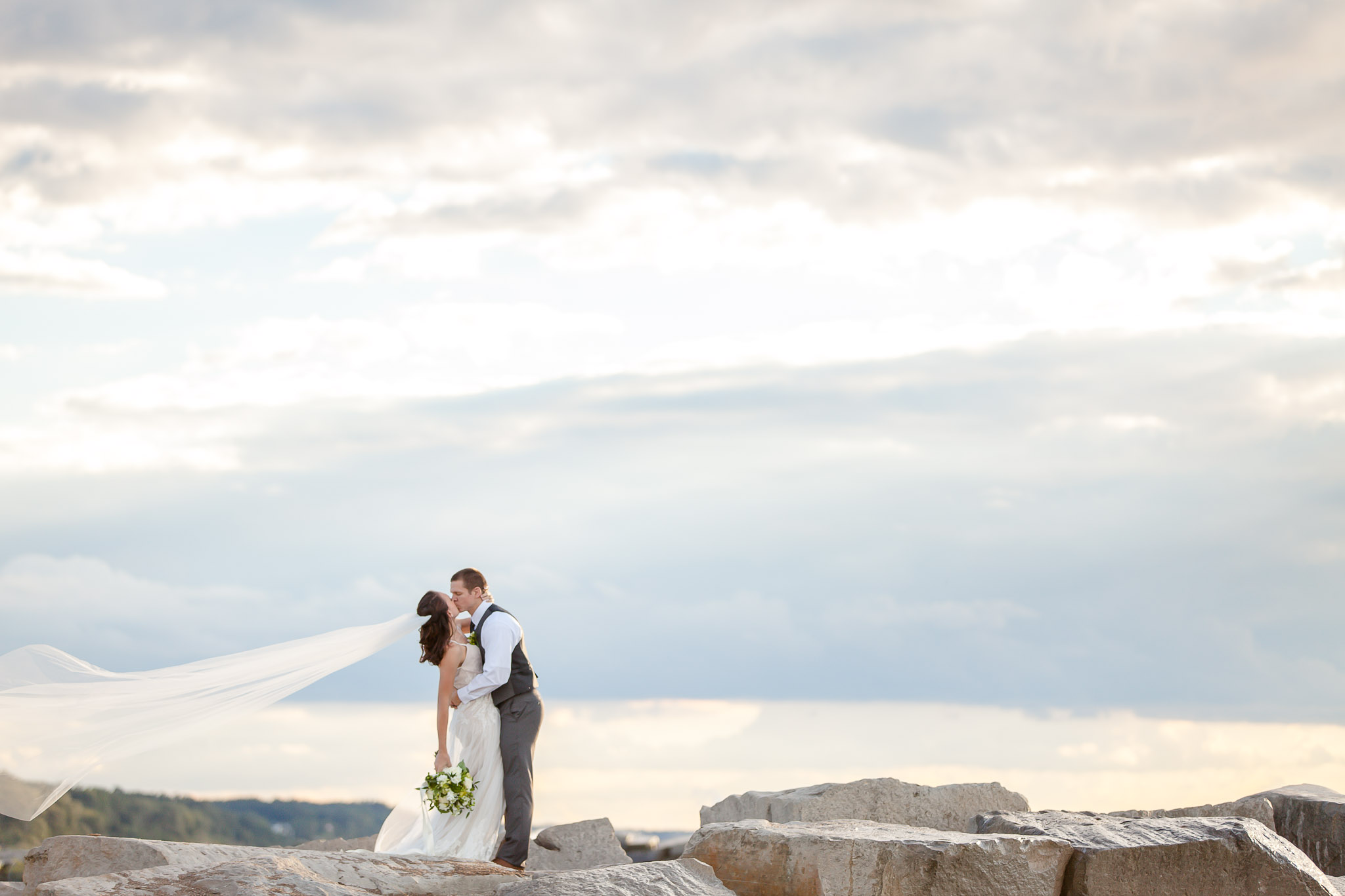 Couple Kissing in New Buffalo Beach - New Buffalo Michigan Wedding Photographer - Toni Jay Photography
